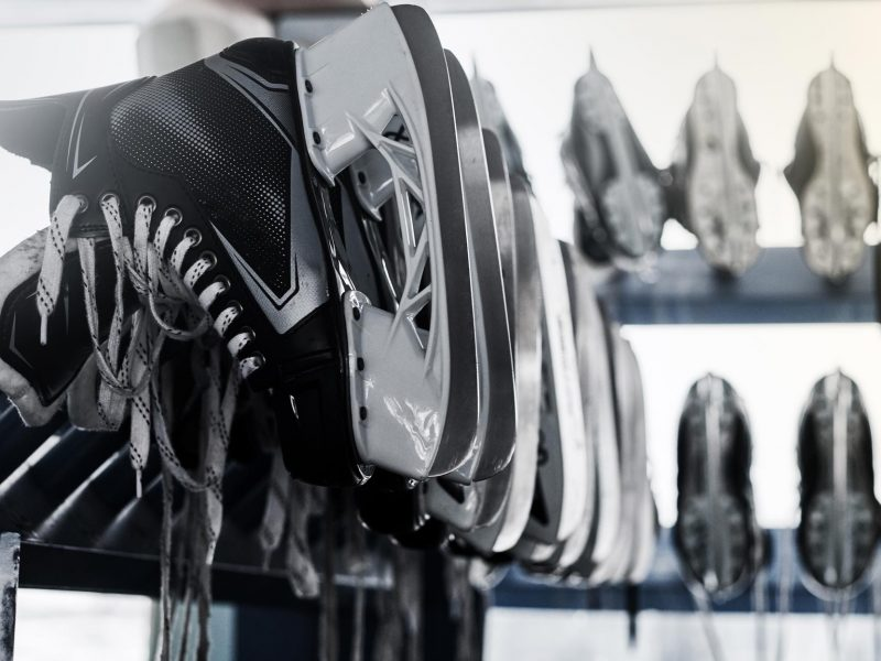 rack-with-many-pairs-of-skates-inside-2VLNSC8